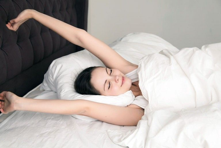 woman-stretching-in-bed